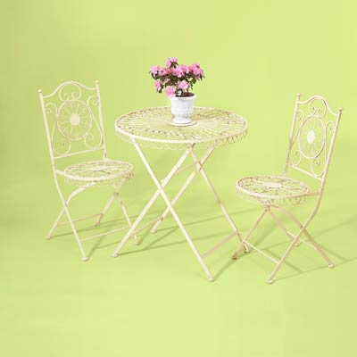 wrought-iron bistro set painted in white