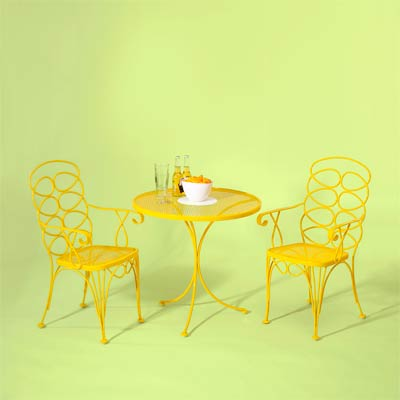 yellow bistro set made of wrought iron