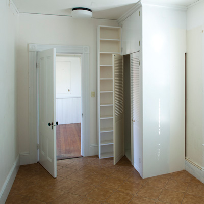 closet and shelving near entryway of TOH TV project house Cambridge before remodel