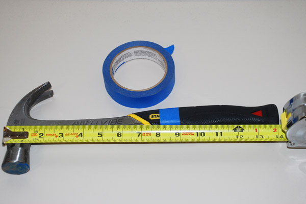 hammer marked with tape to show measurements