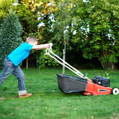kid mowing a lawn