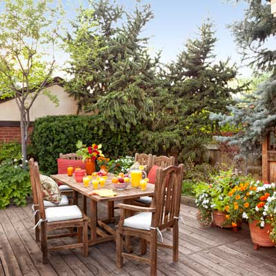 cedar dining deck with bristlecone pine, blue spruce and containers with marigolds, petunias, impatiens, vining mandevilla