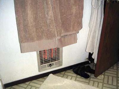 towels hanging too close to bathroom heater