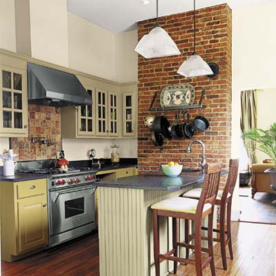 Small kitchen with exposed brick wall, pendant lighting, and stainless steel appliances