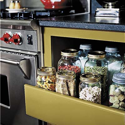 slide out drawers to keep dry goods near the range