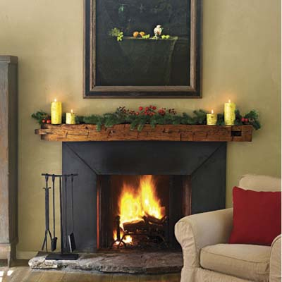 fireplace has a mantel made from salvaged fir beam