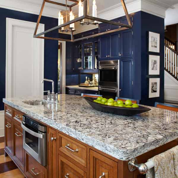 and gray quartz kitchen countertop on island with blue kitchen