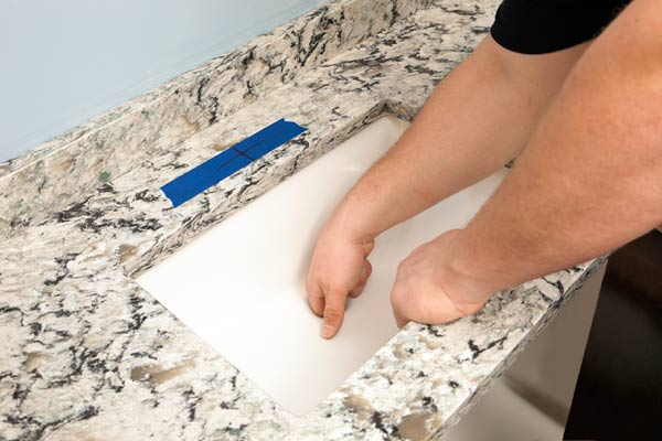 installing a quartz countertop around a kitchen sink