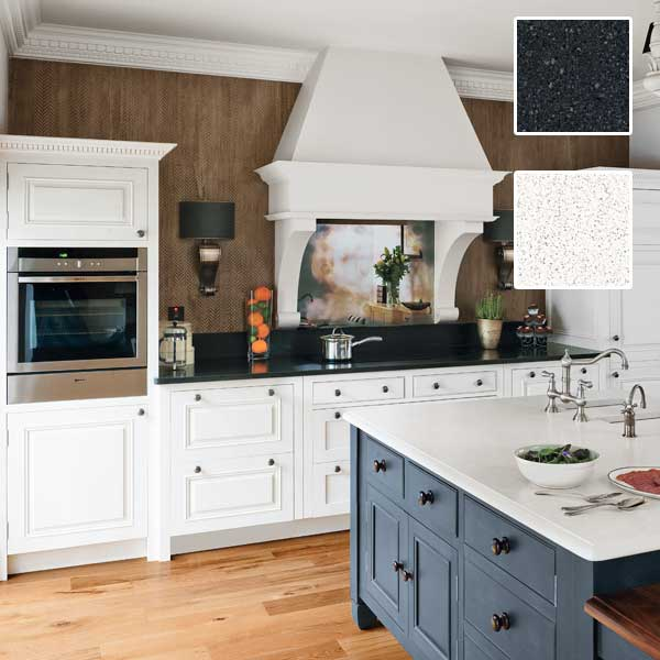 timeless kitchen style kitchen with blacks quartz countetops, white kitchen cabinets and range hood, kitchen island with white quartz countertop and black cabinets