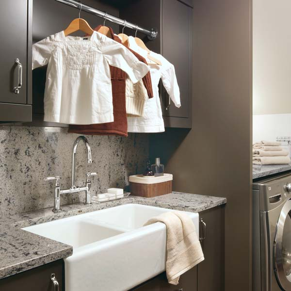 laundry room with gray quartz used for countertop and backsplash