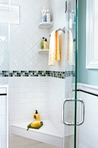 tiled shower with corner seat of quartz countertop