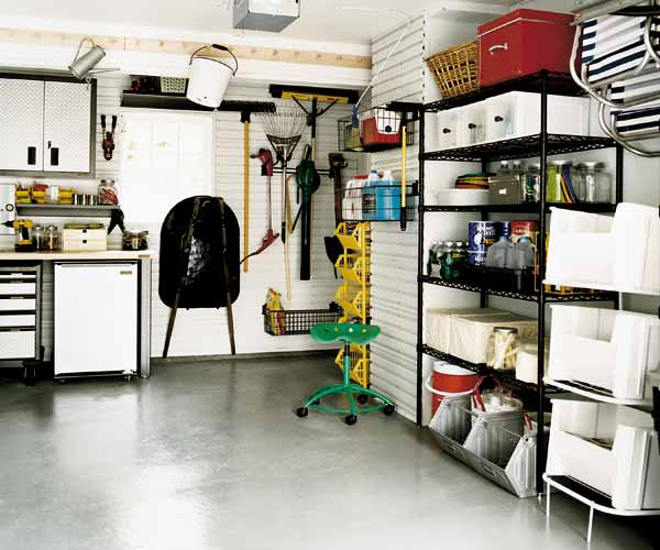 garage with paints and cold sensitive items stored on shelves, easy fall upkeep upgrades