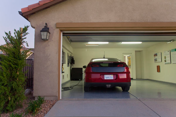 read before you organize your garage car parked in garage with interior garage light