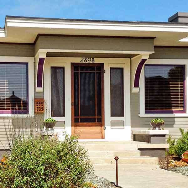 curb appeal boost on budget prairie-style bungalow with multicolor paint scheme