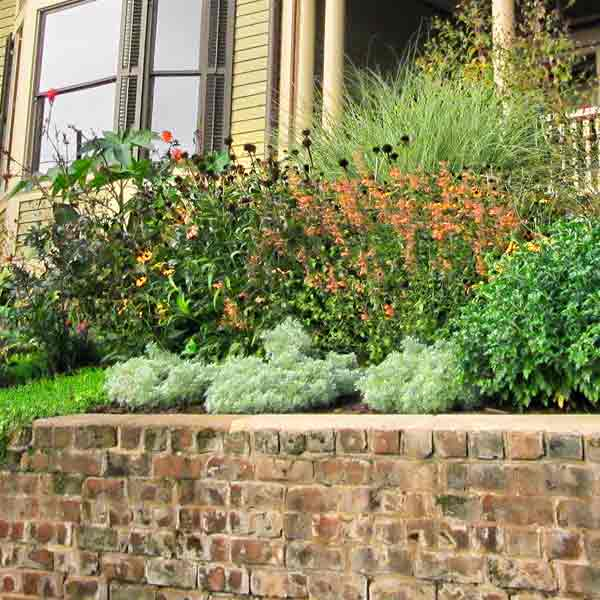 curb appeal boost on budget queen anne style home landscaping with retaining wall, perennial, rain barrel