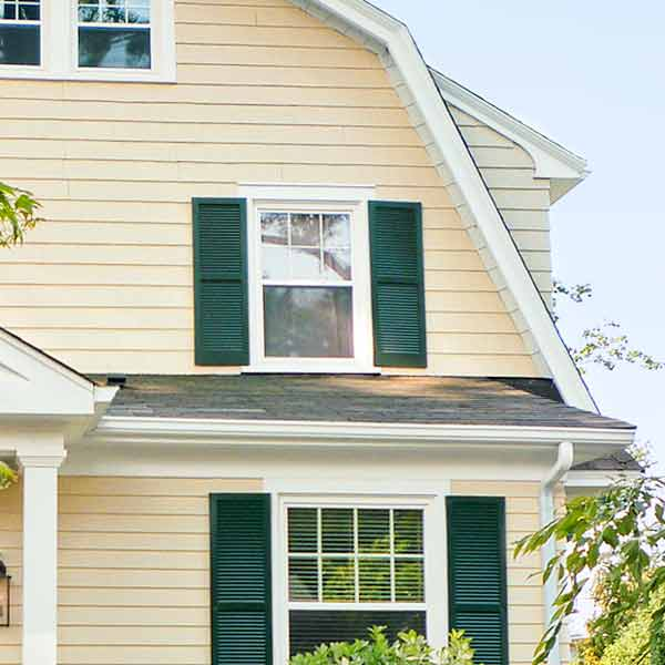 curb appeal boost on budget dutch colonial style home with wood double hung window, wood shutters