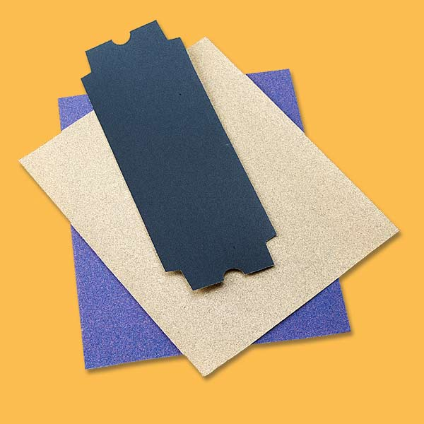 10 uses for sandpaper, loose pieces of sandpaper of varying sizes