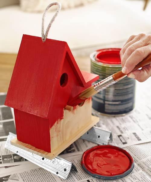 painting a bird feeder red with scraps of drywall corner bead for elevation and support, 10 uses