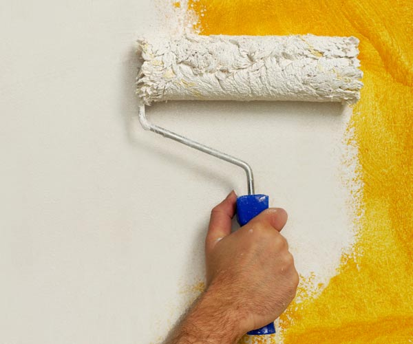 painting white over a yellow textured wall with a paint roller, tips on understanding new types of paint