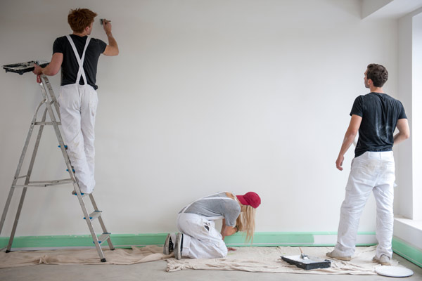 three people painting a room together, tips on understanding new types of paint
