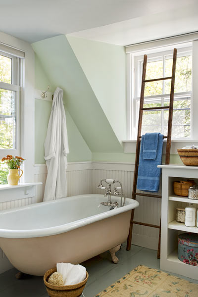 farmhouse whole house remodel master bathroom with salvaged tub, painted floor