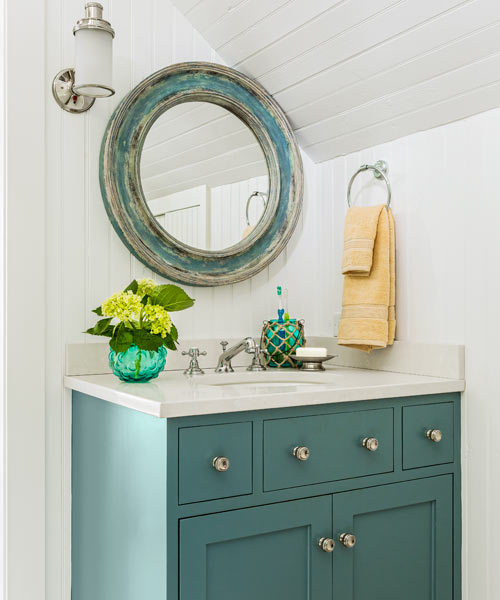 bath on third floor of 1910 shore house with matching teal vanity and mirror
