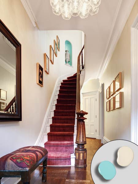 entry hall with off white walls and blue alcove along stairs this old house editor Scott omelianuk colorful rowhouse remodel