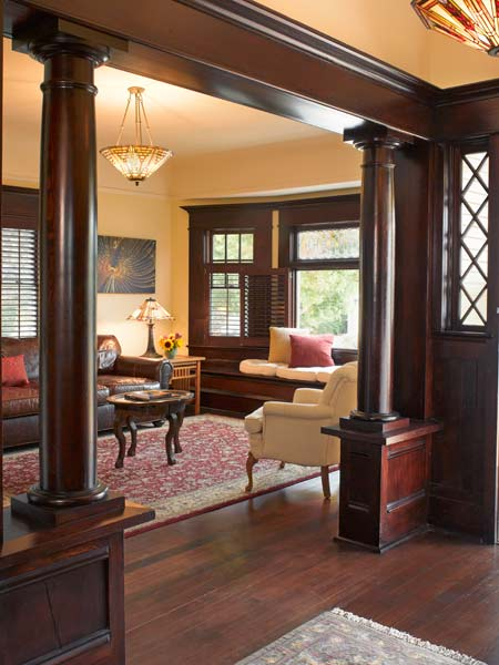 living room with original fir planeling collonnades, classic craftsman green remodel