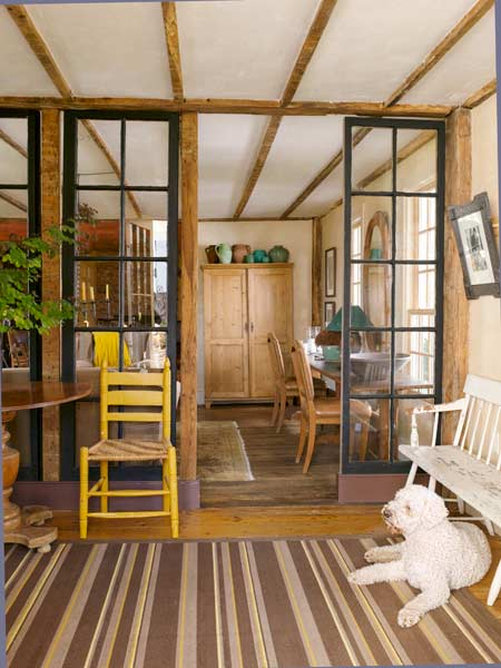 entryway with salvaged French doors of farmhouse remodel with barn addition