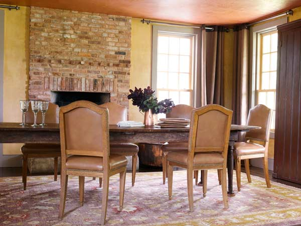 dining room with tinted plaster walls, farmhouse remodel with barn addition