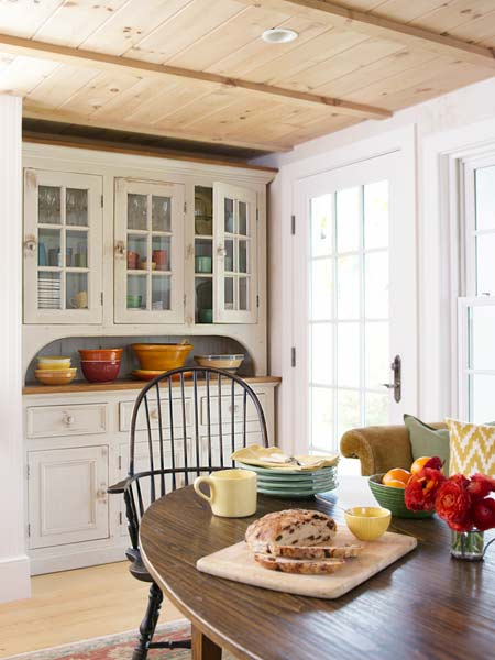 breakfast area with hutch and pottery inside, farmhouse remodel with barn addition