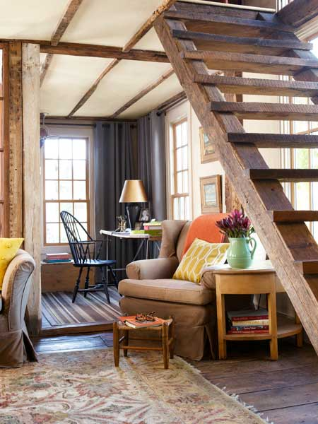 reading room with floating stairs up to master suite, farmhouse remodel with barn addition