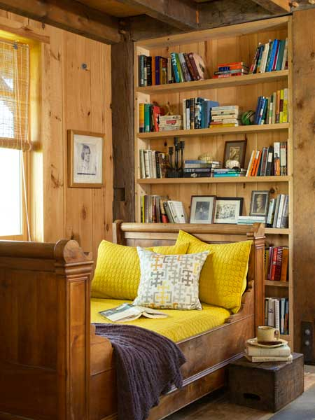reading nook with pine bed and bookcases, farmhouse remodel with barn addition