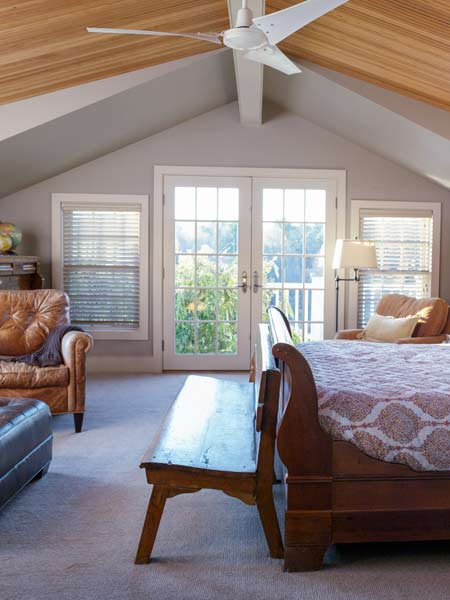 master bedroom with cathedral ceiling and french doors, farmhouse remodel with barn addition
