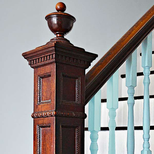 after remodel, close up of original newel post and handrail