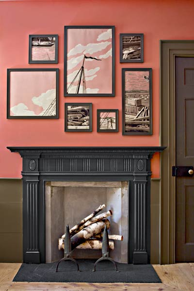 dark painted mantel with matching wall art frames and amber painted walls, paint ideas for mantels