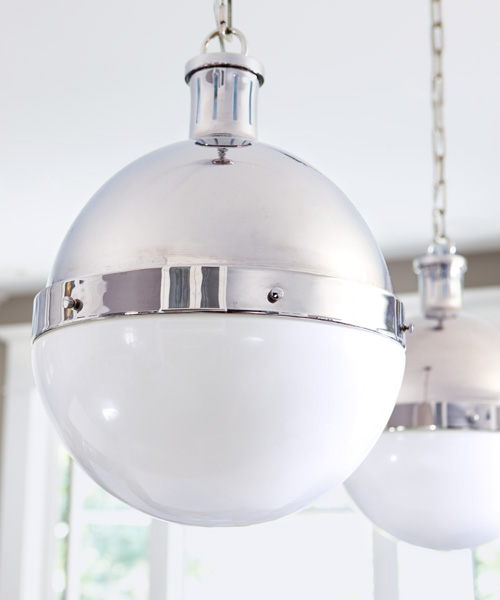 globe lights with industrial metal details in eat in kitchen after remodel
