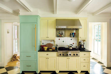 farmhouse style kitchen with pale yellow and green painted kitchen cabinets