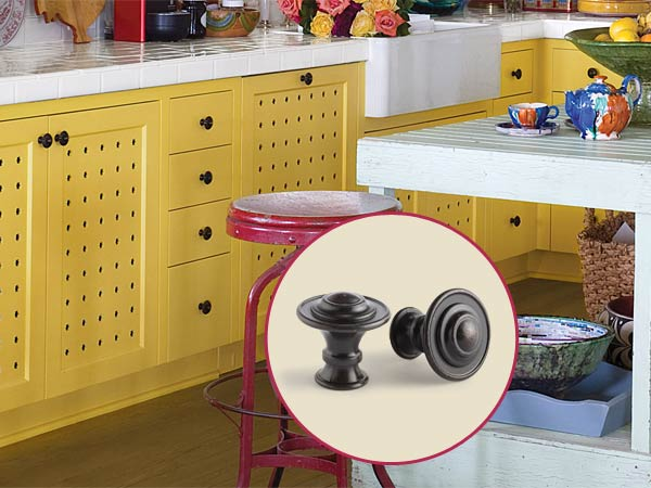 a quirky cottage kitchen with inset of cabinet knobs