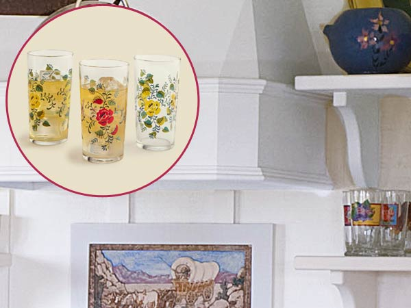 a quirky cottage kitchen with inset of tea glasses