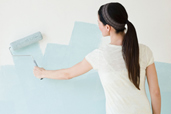 DIY calorie burners woman painting a wall
