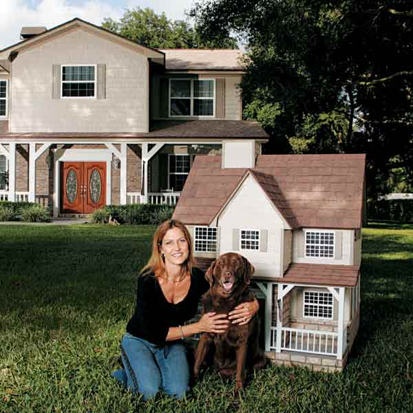 owner with dog and doghouse in imitation of owner's house