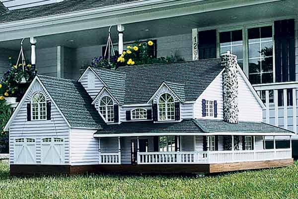 mansion style doghouse with wraparound porch
