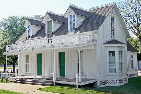 save this old house garland texas oldest house 1870s frontier farmhouse white with green front doors