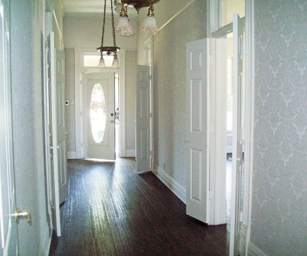 first floor hallway in light blue queen anne farmhouse garland texas save this old house