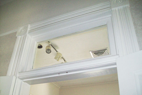 transom above interior door of light blue queen anne farmhouse garland texas save this old house