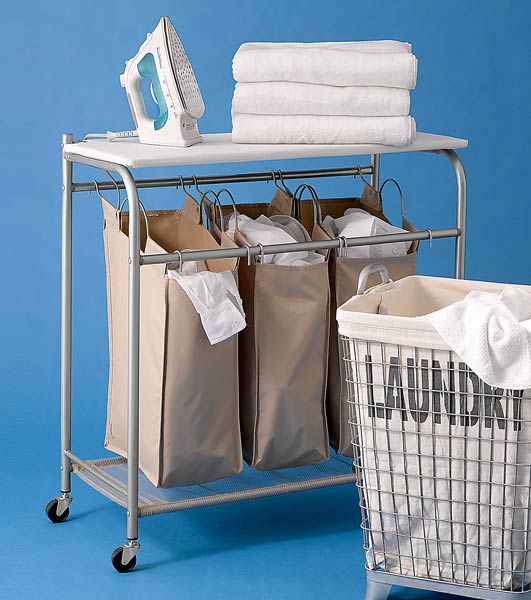 laundry bin with wheels for easy portability, and a hinged ironing-board top that doubles as a folding table