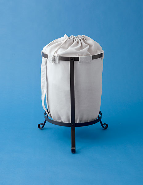 laundry bin with fanciful footed frame