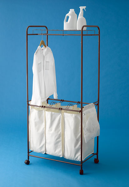 laundry bin with removable totes and lingerie bags to a hanging bar and a supply shelf