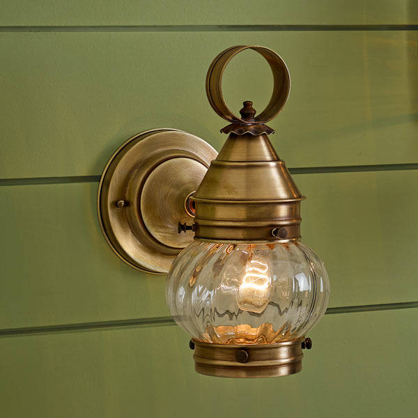 onion-style porch lanterns of solid brass with antiqued finish, handcrafted rippled glass